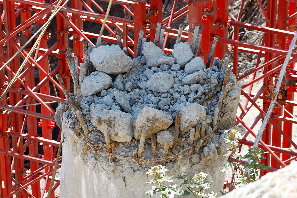 . An old cement bridge pillar remains in place at the Pfeiffer Canyon Bridge consturction site on Highway One in Big Sur on Wednesday, July 19, 2017.  (Vern Fisher - Monterey Herald)