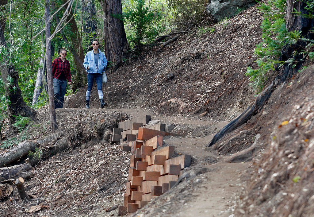 . Two women walk north on the new Pfeiffer Canyon foot trail that is open to residents traveling around the former Pfeiffer Canyon bridge and Pfeiffer Big Sur State Park on Thursday, March 30, 2017.  (Vern Fisher - Monterey Herald)