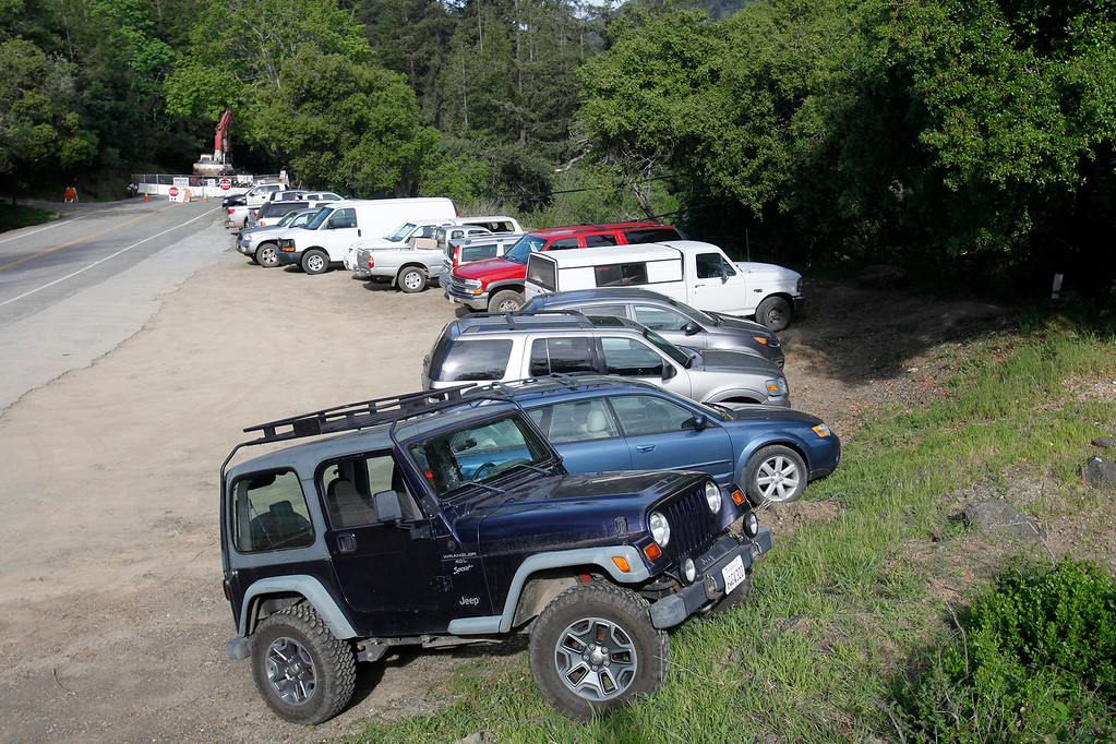 . Vehicles belonging to Big Sur residents parked on the south side of the Pfeiffer Canyon as they use the new Pfeiffer Canyon foot trail that is open to residents traveling around the former Pfeiffer Canyon bridge and Pfeiffer Big Sur State Park on Thursday, March 30, 2017.  (Vern Fisher - Monterey Herald)