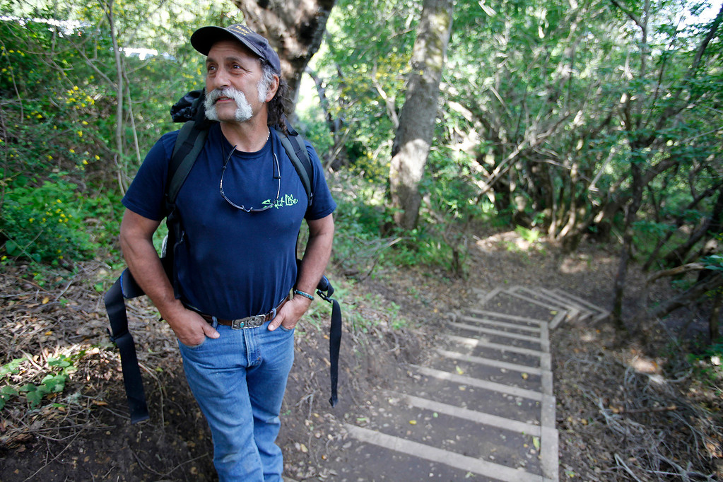 . Mark Siino prepares to head north on the new Pfeiffer Canyon trail that is open to residents traveling around the former Pfeiffer Canyon bridge and Pfeiffer Big Sur State Park on Thursday, March 30, 2017.  (Vern Fisher - Monterey Herald)