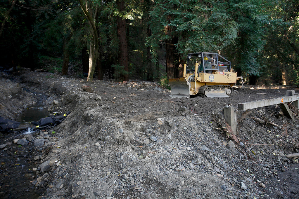. State Park crews work to remove debris flows in the campground area of Pfeiffer Big Sur State Park on Thursday, March 30, 2017.  (Vern Fisher - Monterey Herald)