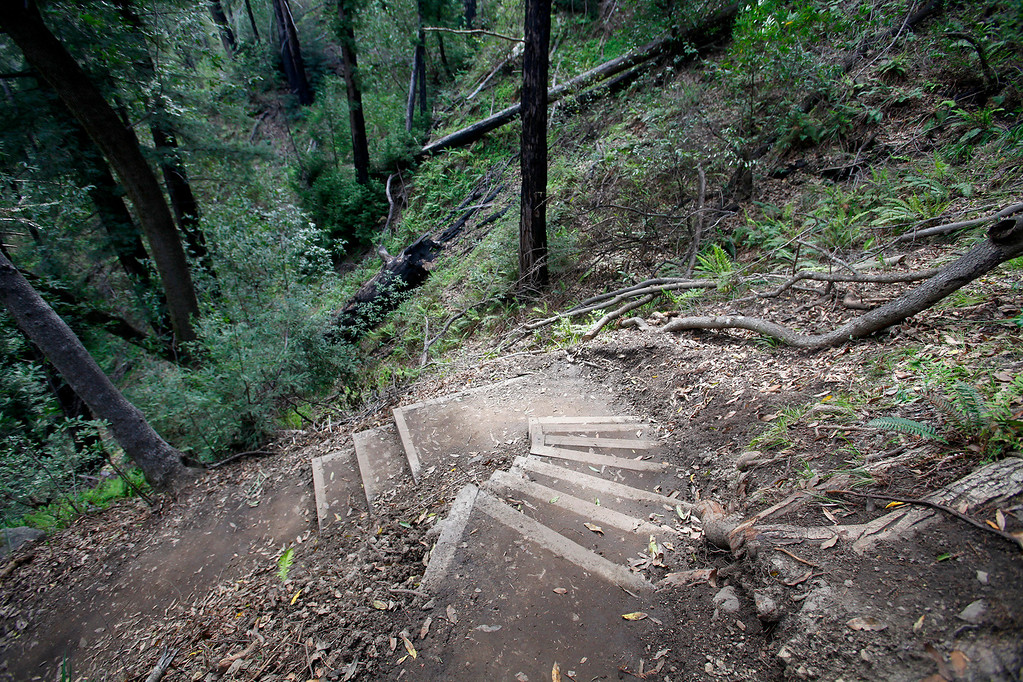 . Steps around a switchback on the new Pfeiffer Canyon foot trail that is open to residents traveling around the former Pfeiffer Canyon bridge and Pfeiffer Big Sur State Park on Thursday, March 30, 2017.  (Vern Fisher - Monterey Herald)