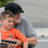 Phase one of the Mechanic Street Park is done and a ceremony to official open the park was held on Wednesday morning, July 17, 2019. Listening to the speakers at the ceremony is Marine veteran Paul Rife with Jonah Rife, 5. SENTINEL & ENTERPRISE/JOHN LOVE