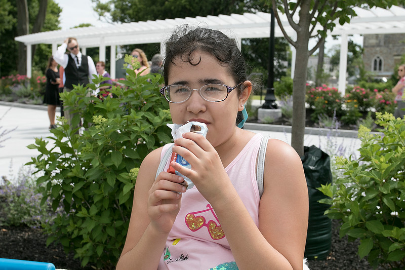 Phase one of the Mechanic Street Park is done and a ceremony to official open the park was held on Wednesday morning, July 17, 2019. Enjoying some ice cream just before the ceremony started is Kimberley Viera Ayala, 9. SENTINEL & ENTERPRISE/JOHN LOVE