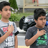 Phase one of the Mechanic Street Park is done and a ceremony to official open the park was held on Wednesday morning, July 17, 2019. Local residents Eric Onofre, 11, and his brother Miguel Onofre, 8, put their hands over their hearts as the flag is new flag is raised and the national anthem is sung during the ceremony. SENTINEL & ENTERPRISE/JOHN LOVE
