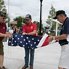 Phase one of the Mechanic Street Park is done and a ceremony to official open the park was held on Wednesday morning, July 17, 2019. Raising the flag on the new flag pole is, from left, veterans Frank Ardinger, Bob Haskell and Robert Grudziecki.  SENTINEL & ENTERPRISE/JOHN LOVE