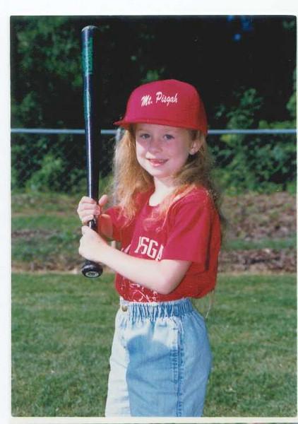 Phia at coach-pitch baseball. (Coach Carter.)