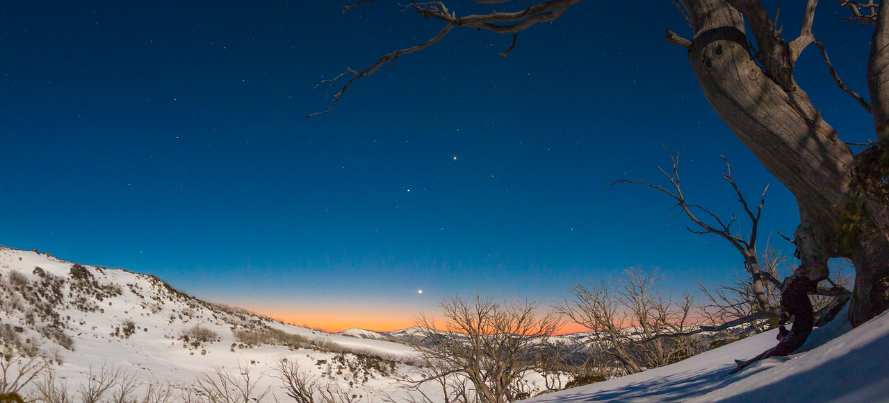 Planets align over Snowy Mountains