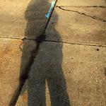 Sidewalk Shadow of a Man