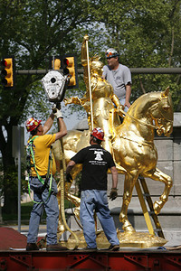 this is NOT my picture...it is from Philly.com but I felt it was useful to give the history behind the statue that I see everyday at The Philadelphian...As the reinstallation begins, ironworkers rig the statue before it can be hoisted from a flatbed truck and placed back on its pedestal at 25th Street and Kelly Drive.