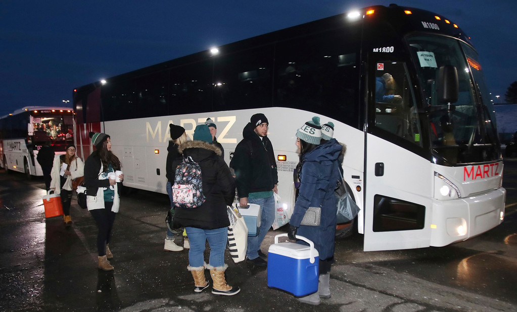 . Philadelphia Eagles NFL football team fans wait to board buses to Philadelphia for the Super Bowl champions parade, in Wilkes Barre Township, Pa., early Thursday, Feb. 8, 2018. (Dave Scherbenco/The Citizens\' Voice via AP)