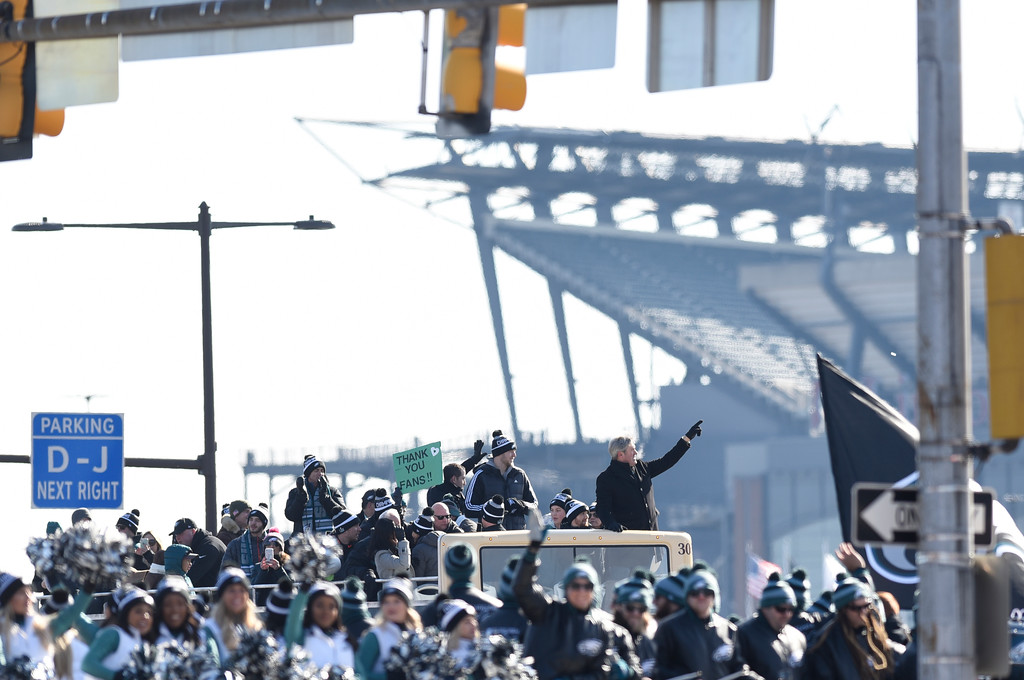 . Philadelphia Eagles NFL football team head coach Doug Pederson points to the crowd gathered during the Super Bowl LII victory parade, Thursday, Feb 8, 2018, in Philadelphia. (AP Photo/Michael Perez)