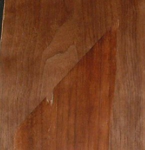 Here is the back of a piece of the original veneer on top of the new patch. Both were wiped with mineral spirits to reveal colors. Note the match is excellent except the old walnut is redder as it tends to turn with age. Some mahogany stain will match it in.
