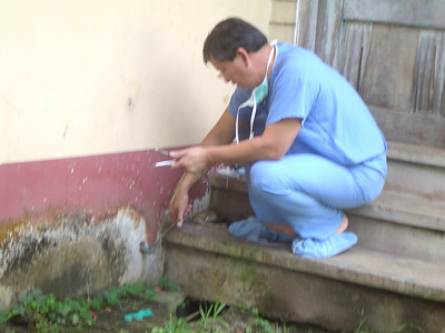 Carl, one of our anesthesiologists, is clearing the hose which will will vent our anesthetic gases.  Otherwise, we will fall asleep while we work.