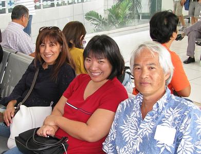 Greta, Tracie, Bwong at domestic airport.