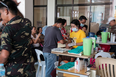 One of four Filipino dentists performing extractions.