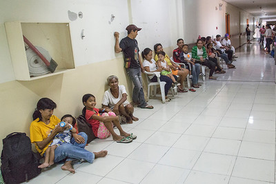 Patients and families waiting to be seen at in-take clinic.