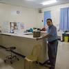 Alex Hermoso, fair trade consultant, at the front desk, OR of the James L. Gordon Memorial Hospital, Olongapa City.