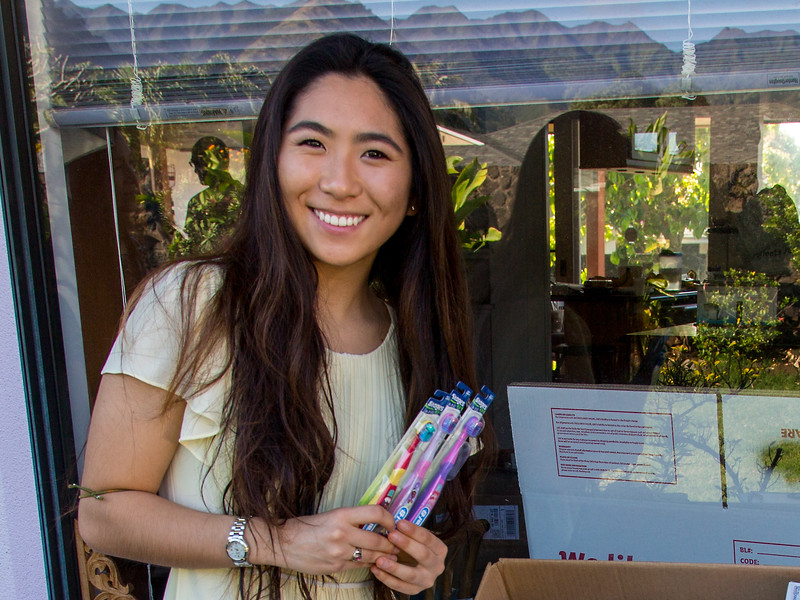 Cierra Nakamura donates toothbrushes and toothpaste to the dental team.
