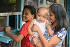 A woman and her baby in Guadalupe, Cebu City, Philippines taken in March 2009