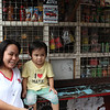 Cindy Sumbong and her son outside her sorri sorry store