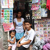 Gerlie Balani and her two children.<br /> She sells all kind of toys and products to here neighbors