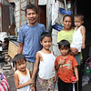 Edna Alcaraz and her family at there home. She recently added a sori sori store business in addition to her Junk shop
