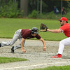photo Scott LaPrade A Rochdale player is out at 1st base by Pat Gilman as he attempted to steal and tried to turn back to 1st.