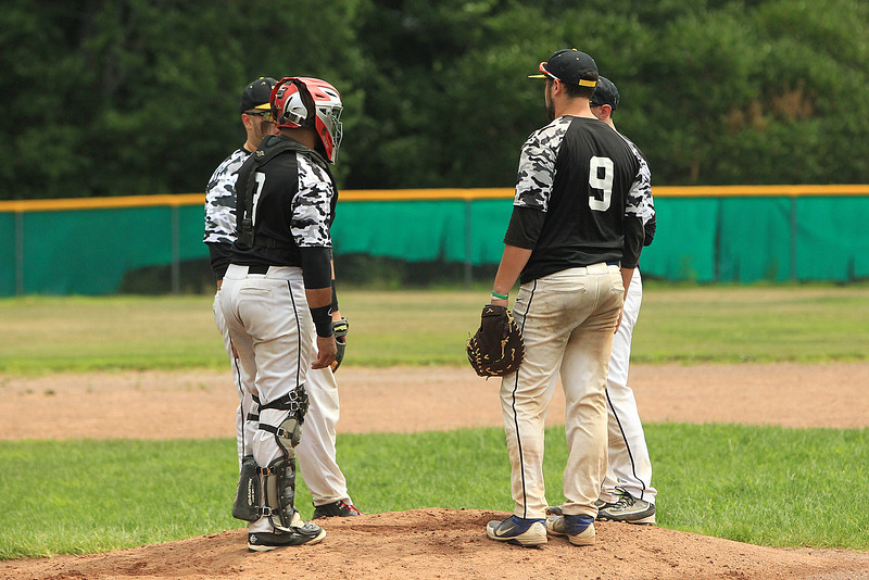 Worc Pirates have a pitchers meeting after loading the bases in the 1st inning