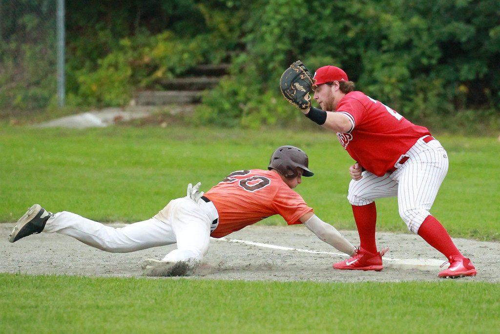 . Brennan Cuddahy attempts the tag at 1st SENTINEL&ENTERPRISE/Scott LaPrade