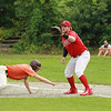 The ball a little late to 1st baseman Brennan Cuddahy SENTINEL&ENTERPRISE/Scott LaPrade