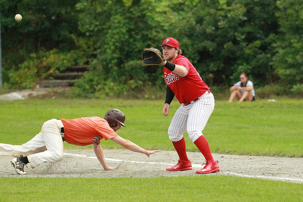 . The ball a little late to 1st baseman Brennan Cuddahy SENTINEL&ENTERPRISE/Scott LaPrade