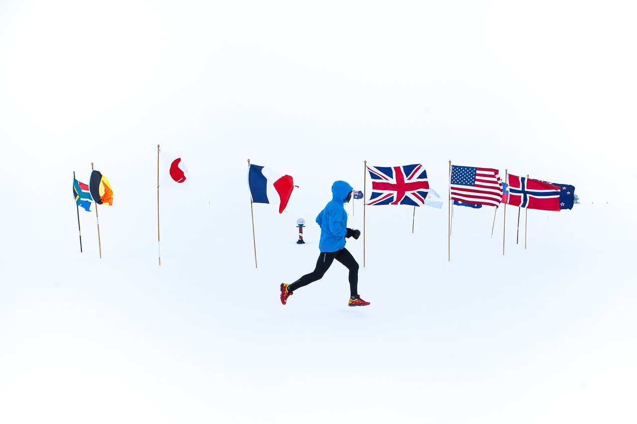 Running past the ceremonial South Pole.