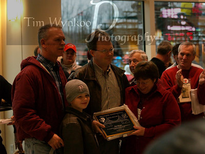 Jim Ringo's family accepts his plaque. Bruce Smith, left.