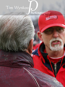 Phillipsburg High School Head Coach, Bob Stem, on left speaks with Easton's Doug Powell.