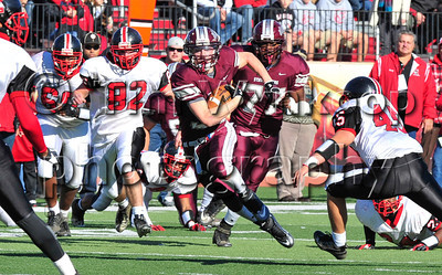 11/22/2012, Easton, PA: Phillipsburg's Alex Martin (32), run the ball around Easton's Nolan Kilpatrick (45). Phillipsburg vs Easton at Lafayette College's Fisher Field. First half.|