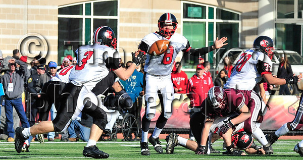 11/22/2012, Easton, PA: Easton's Kyle Bambary (3), left, reaches for a pass by quarterback, Brad Wilkins (8) in the first half of play. Phillipsburg vs Easton at Lafayette College's Fisher Field. First half.