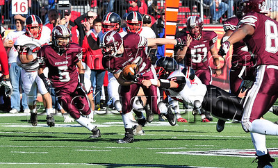 11/22/2012, Easton, PA: Easton's Nolan Kilpatrick (45), right, reaches for Phillipsburg's Alex Martin (32). Phillipsburg vs Easton at Lafayette College's Fisher Field. First half.|