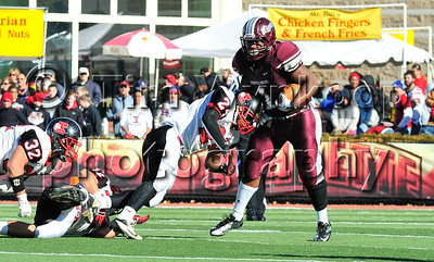 11/22/2012, Easton, PA: Easton's Justin Best (24), left, plows into Phillipsburg, DaJuan Lee (1). Phillipsburg vs Easton at Lafayette College's Fisher Field. First half.|