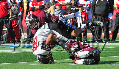11/22/2012, Easton, PA: Easton's Mason Herrman (85) tumbles on his head after being tripped up by Phillipsburg's Connor Lilly (13) top, and Alex Martin (32) Bottom. Phillipsburg vs Easton at Lafayette College's Fisher Field. First half.|