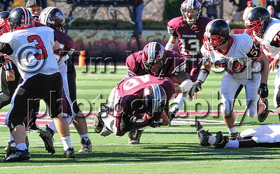 11/22/2012, Easton, PA: Phillipsburg's Taji Lowe (48) falls to the ground with the ball on a play in the 2nd quarter. Phillipsburg vs Easton at Lafayette College's Fisher Field. First half.|
