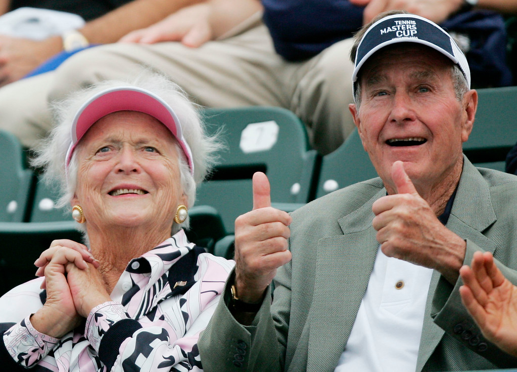 ". FILE - In this Nov. 16, 2004 file photo, former President George Bush, right, gives a thumbs-up while he and his wife, Barbara, left, attend the Tennis Masters Cup tournament in Houston. With her husband still at her side, Barbara Bush has decided to decline further medical treatment for health problems and focus instead on ""comfort care\"" at their home in Houston. Family spokesman Jim McGrath disclosed Barbara Bush\'s decision Sunday, April 15, 2018. (AP Photo/David J. Phillip, File)"