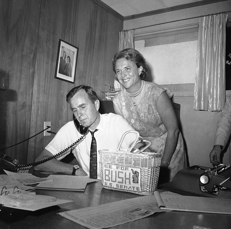 ". FILE - In this June 6, 1964 file photo, George Bush, candidate for the Republican nomination for the U.S. Senate, gets returns by phone at his headquarters in Houston as his wife Barbara, beams her pleasure at the news. Former first couple George and Barbara Bush\'s relationship is a true love story, described by granddaughter Jenna Bush Hager as ""remarkable.\"" They met at a Christmas dance. She was 17. He was 18. Two years later they were married. Now 73 years later, with Barbara Bush declining further medical care for health problems, they are the longest-married couple in presidential history. (AP Photo/Ed Kolenovsky, File)"