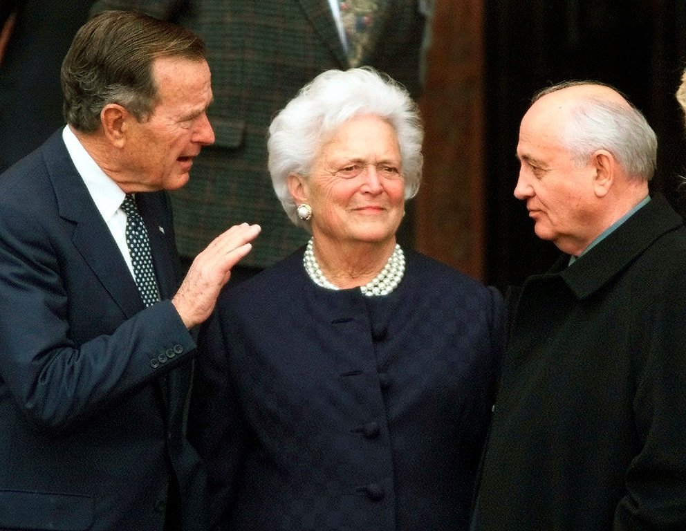 . FILE - In this Nov. 8, 1999, file photo, former U.S. President George H.W. Bush, left, chats with former Soviet leader Mikhail Gorbachev, right, as Barbara Bush looks on before Bush was awarded the honorary citizenship of Berlin. A family spokesman said Tuesday, April 17, 2018, that former first lady Barbara Bush has died at the age of 92. (AP Photo/Herbert Knosowski, File)