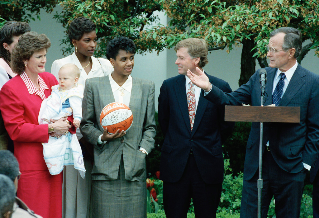 . FILE - In this April 22, 1991, file photo, President George Bush, right, honors the University of Tennessee woman\'s NCAA college basketball tournament champions in the White House Rose Garden. From left are head coach Pat Summitt holding her baby Tyler, Daedra Charles, Dena Head and Vice President Dan Quayle. Daedra Charles-Furlow, known as Daedra Charles when she played for Tennessee from 1988-91, a women\'s basketball Hall of Famer who played on Tennessee\'s 1989 and 1991 national championship teams, has died. She was 49. Lisa Croff, spokesperson for the Wayne County (Michigan) morgue, confirmed Monday that Charles-Furlow died Saturday, April 14, 2018, in Wayne County. (AP Photo/Barry Thumma, File)