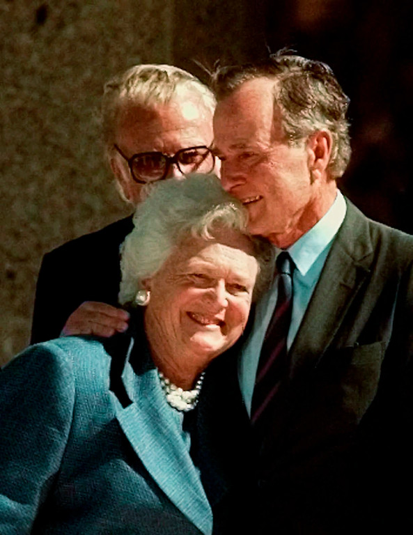 """. FILE - In this Nov. 6, 1997, file photo, former President George Bush hugs his wife, Barbara, after his address during the dedication of the George Bush Presidential Library in College Station, Texas. With her husband still at her side, Barbara Bush has decided to decline further medical treatment for health problems and focus instead on \""""comfort care\"""" at their home in Houston. Family spokesman Jim McGrath disclosed Barbara Bush\'s decision Sunday, April 15, 2018. (AP Photo/Pat Sullivan, File)"""