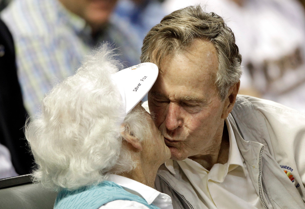 ". FILE - In this May 5, 2010 file photo, former U.S. President George H.W. Bush, right, kisses his wife, Barbara, after both were shown on the stadium kiss cam video board during the sixth inning of a baseball game against the Arizona Diamondbacks in Houston. Former first couple George and Barbara Bush\'s relationship is a true love story, described by granddaughter Jenna Bush Hager as ""remarkable.\"" They met at a Christmas dance. She was 17. He was 18. Two years later they were married. Now 73 years later, with Barbara Bush declining further medical care for health problems, they are the longest-married couple in presidential history. (AP Photo/David J. Phillip, File)"