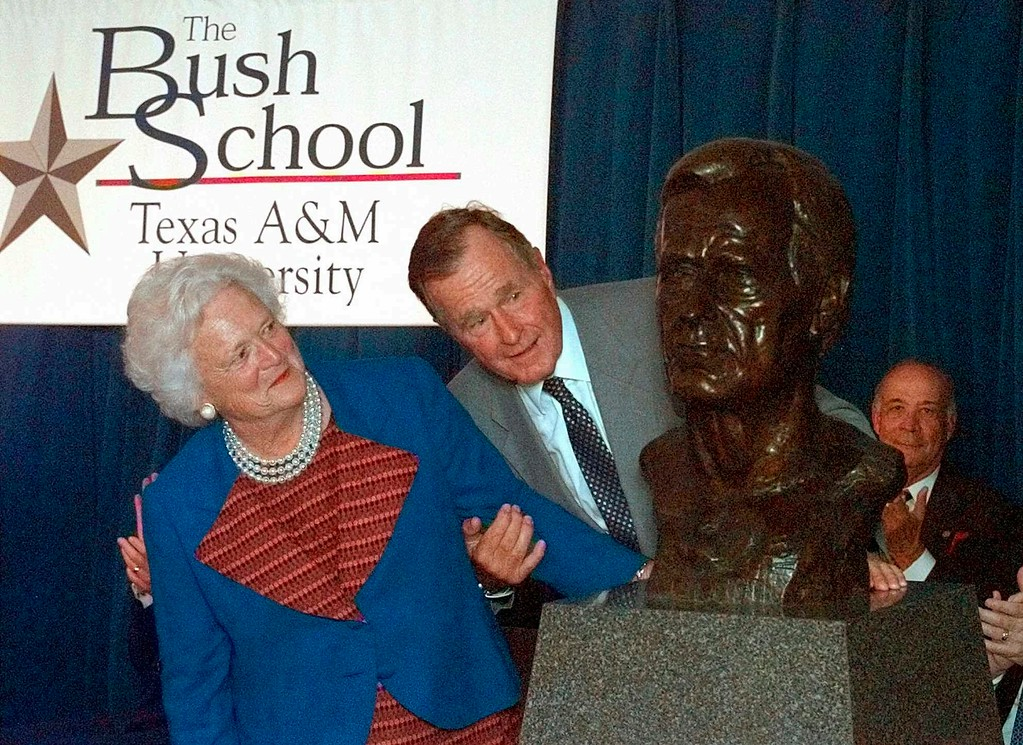 ". FILE - In this Sept. 10, 1997 file photo, former President George Bush and his wife Barbara unveil a bust of the president during a ceremony to open The Bush School of Government and Public Service at Texas A&M University in College Station, Texas. Former first couple George and Barbara Bush\'s relationship is a true love story, described by granddaughter Jenna Bush Hager as ""remarkable.\"" They met at a Christmas dance. She was 17. He was 18. Two years later they were married. Now 73 years later, with Barbara Bush declining further medical care for health problems, they are the longest-married couple in presidential history. (AP Photo/David J. Phillip)"