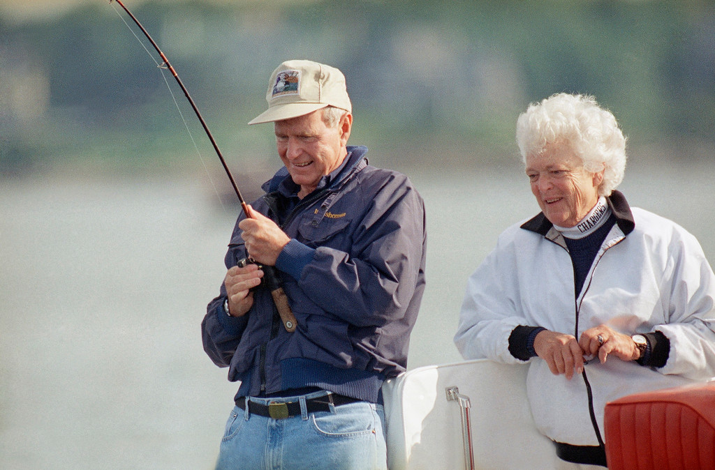 ". FILE - In this Aug. 7, 1991, file photo, Barbara Bush watches as President George Bush reels in a fish aboard their boat Fidelity, just off shore from their Vacation home at Walkers Point in Kennebunkport, Me. Former first couple George and Barbara Bush\'s relationship is a true love story, described by granddaughter Jenna Bush Hager as ""remarkable.\"" They met at a Christmas dance. She was 17. He was 18. Two years later they were married. Now 73 years later, with Barbara Bush declining further medical care for health problems, they are the longest-married couple in presidential history. (AP Photo/Susan Walsh, File)"