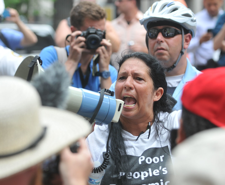 PETE BANNAN DIGITAL FIRST MEDIA  Cheri Honkala speaks to supporters during a rally at Philadelphia City Hall Monday.   Honkala  is co-founder and National Coordinator of the Poor People's Economic Human Rights Campaign and co-founder of the Kensington Welfare Rights Union.
